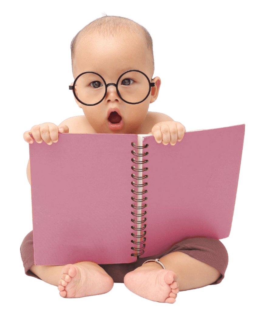 Baby sitting up and holding a large open pink notebook. The baby is nearly bald, and is staring open-mouthed at the viewer, as if in shock. There are large round glasses on the baby's face. The notebook is pink and spiral bound. (Joey333, Getty Images)